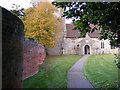 TM2858 : Wiggly Wall & All Saints Church Path by Adrian Cable