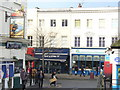 Outside Surbiton Station is the busy Victoria Road with its ground level shops. On the left is the Southampton Flyer pub. Surbiton is on the London - Southampton line but these trains tend not to stop at Surbiton - change at Woking, Clapham Junction or Waterloo.