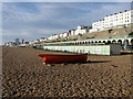 TQ3203 : Boat and Beach Huts by Simon Carey