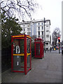 Dist:0.1km<br/>Old and new styles of telephone boxes.