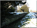 TL1490 : Sunken wall at Folksworth church by Michael Trolove