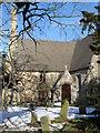 TL1490 : Church porch, Folksworth by Michael Trolove