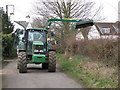 TL1968 : Hedge cutting in Hardwick Lane by Michael Trolove