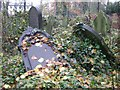 SP0590 : Fallen memorials, Handsworth parish churchyard by Robin Stott