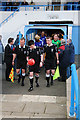 Dist:0.2km<br/>The referee and his assistants lead the teams out of the tunnel for the Wingate & Finchley v Cheshunt match.   The unusual colour of the ball was a Ryman League initiative for Red Nose Day and collection buckets were available at the ground.
