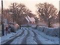 SJ5162 : Hoofield Road in light snow by John Lindsay