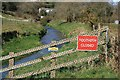 SX0049 : St Austell River erosion by John Gibson