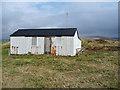 NG3535 : Corrugated iron shed in Portnalong by John Allan