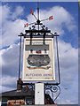 TM4360 : Butchers Arms Public House sign by Adrian Cable