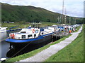 NN2896 : The Eagle, floating pub at Laggan Lock by Nicholas Mutton
