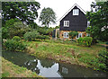 TL2247 : Cottage adjacent to Sutton Packhorse Bridge by Christine Matthews