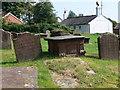 SJ3174 : Gravestones at St Nicholas', Burton-in-Wirral by Eirian Evans