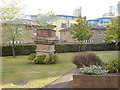 TQ3780 : Lawn and Feature in Premiere Place, E14 by Danny P Robinson