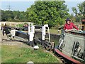 SP9122 : Passing Lock No 28 –  Narrowboat Lynx (5) – Closing the top gate by Chris Reynolds