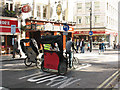 TQ3080 : Rickshaws in St Martin's Lane by Stephen Craven
