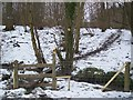 TQ8231 : Stile and footbridge in Pookwell Wood by David Anstiss