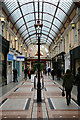 Photo of Bournemouth Arcade and Henry Joy blue plaque