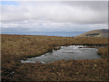 SH6322 : Boggy pond on the Diffwys ridge by Rudi Winter