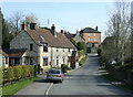 ST6364 : 2010 : Main road through Woollard by Maurice Pullin