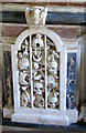 TF8014 : The church of St George in South Acre - C17 monument (detail) by Evelyn Simak