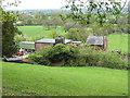 SJ8677 : Outbuildings at Clock House Farm by Stephen Craven