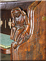 TF6211 : The church of SS Peter and Paul in Watlington - C15 bench end by Evelyn Simak