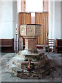TF6119 : St Peter's church in West Lynn - baptismal font by Evelyn Simak
