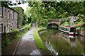 SD9905 : Bridge 77 on the Huddersfield Narrow Canal by Bill Boaden