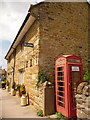 SY5785 : Abbotsbury: phone box and old school house by Chris Downer