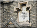 TQ1875 : Plaque on the addition to Hickey's Almshouses by Stephen Craven
