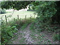 ST7559 : Byway hill up to the railway bridge by James Ayres