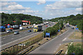 TQ4254 : M25 past Clacket Lane Services by Oast House Archive