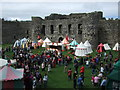 SH6076 : Gathering at Beaumaris Castle by Richard Hoare