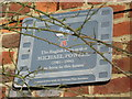 Photo of Michael Powell film cell plaque