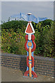 TQ7469 : Millennium Milepost by Ian Capper