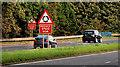 J2459 : Roundabout signs, Hillsborough bypass by Albert Bridge