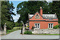 Dist:0.7km<br/>The South Lodge to Sansaw, built of very orange brick, with gate piers topped by eagles. The lodge was built in 1888 when J.F. Doyle enlarged the house for James Jenkinson Bibby, a Liverpool cattle feed and shipping magnate.