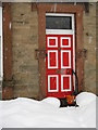 NT2469 : Red door in the snow by M J Richardson