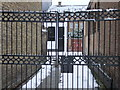TQ2781 : Gates at entrance to  Watsons Mews by PAUL FARMER