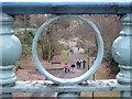 SZ1091 : Boscombe Chine Gardens: view through an ironwork circle : Week 1