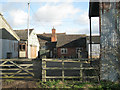 SP2262 : Buildings round a yard, Blacon Farm by Robin Stott