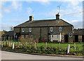 TL5854 : Cottages at Lark Hall Corner by John Sutton