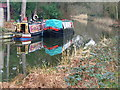 Dist:0.3km<br/>Boats moored on a quiet canal stretch at Sheerwater.