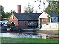 SJ9033 : Boatyard sheds alongside Trent and Mersey Canal by David Martin