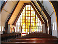 TQ2846 : West window of the church of Christ the King by Stephen Craven