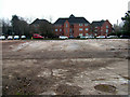 TL8464 : Trinity Mews from demolition site by John Goldsmith
