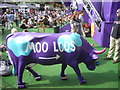 TQ3080 : Moo Loos sign on a cow at E4 Underbelly by PAUL FARMER