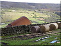 NZ0200 : Bales and barn near Reeth by Miss Steel
