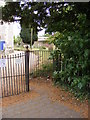 TM3055 : Kissing Gate at the entrance to All Saints Church by Adrian Cable