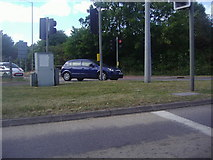SU8369 : Traffic lights from A329 on Coppid Beech roundabout by David Howard